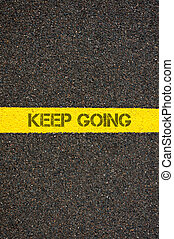 Road marking yellow line with words KEEP GOING - Road...