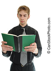 Businessman Reading - Young businessman reading a small...