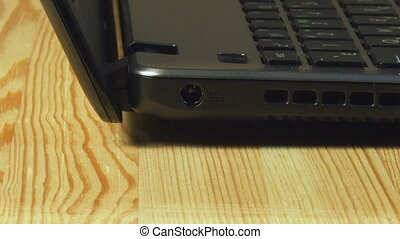 Close-up view of man insert laptop battery charge