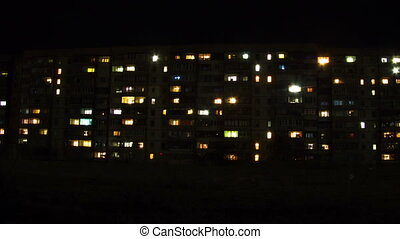 Multistorey Building with changing Window Lighting at Night....