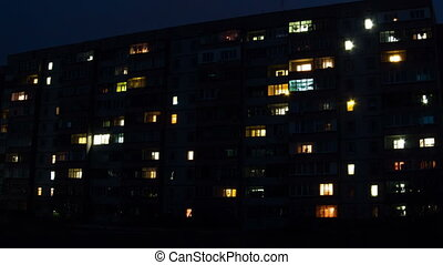 Multistorey Building with changing Window Lighting at Night...