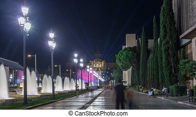Way to Magic Fountain light show timelapse hyperlapse at night next to National museum in Barcelona, Spain. 1000 years of art