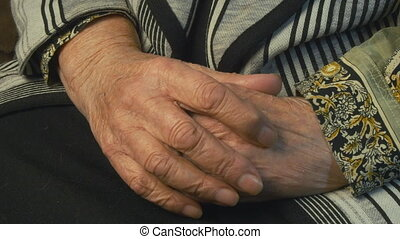 Senior woman massages painful hands