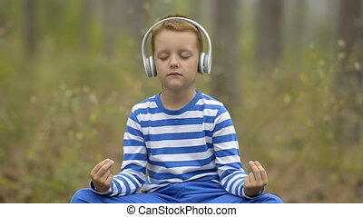 Handsome Little Boy Meditating - Little Boy Meditating...