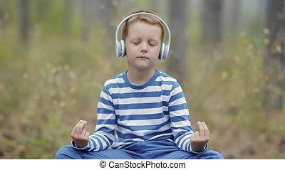 Cute Little Boy Meditating
