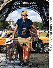 Tourist on vacation with a luggage in Paris
