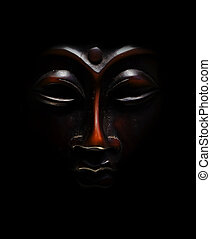 brown budda mask black  in black background
