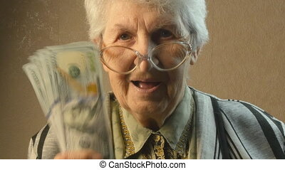 Old woman rejoices money