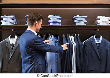 Shopping - Young businessman in store