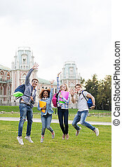 Happiness - Jumping young student in campus