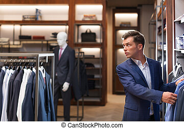 Manager in store - Businessman in suit indoors