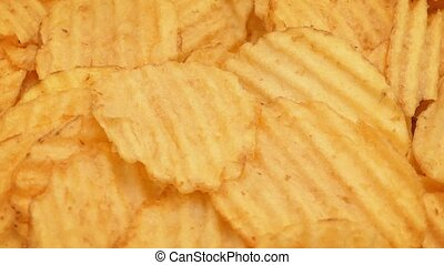Crinkle Cut Potato Chips Rotating - Bowl of crinkle-cut...
