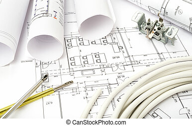 Architecture plan and rolls of blueprints with cable....