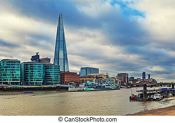 HSM Belfast and Shard in London, UK - View of HSM Belfast on...