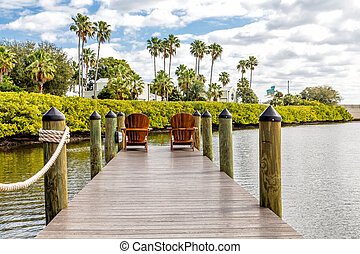 Two Adirondack Chairs on Pier - Adirondack chairs on a...
