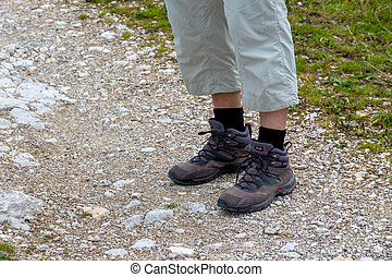 man in hiking boots - woman in hiking boots, symbolizing...
