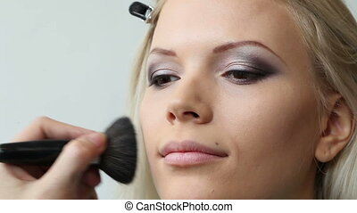 professional make up artist working on model