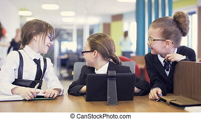 school children communicate and laugh - kids communicate in...