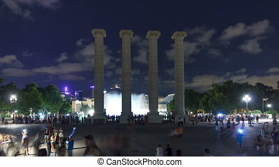 Night view of Magic Fountain light show timelapse hyperlapse witih column Barcelona, Catalonia, Spain.