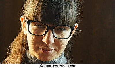Portrait young smiling woman wearing glasses.