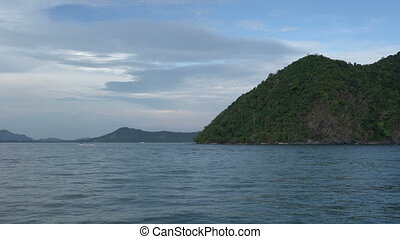 River trip on Phuket island. - High hills with green trees...