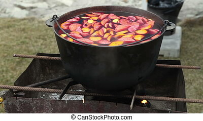 Cast iron pot with mulled wine Russian holiday Maslenitsa