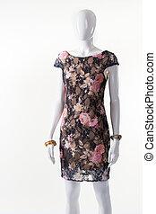 Dark floral dress on mannequin. Female mannequin in dark...