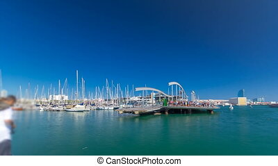 Rambla de Mar wooden walkway timelapse over Port Vell in the city of Barcelona at day in Catalonia, Spain.