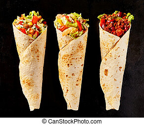 Trio of Tex Mex Fajita Wraps on Black Background - High...