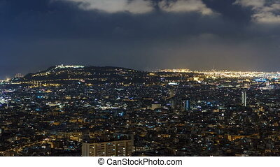 View of Barcelona timelapse, the Mediterranean sea, montjuic mountain from Bunkers Carmel. Catalonia, Spain.