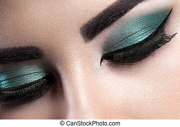 Fashion woman eye makeup. Close-up macro