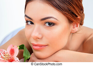 Beautiful young woman at a spa salon. Concept of body care...