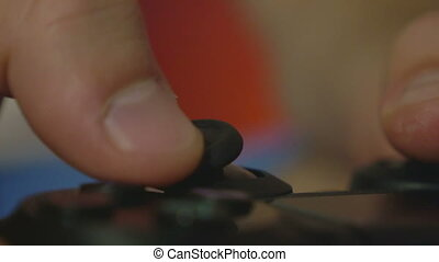 Close-up of man hands playing console games with a controller