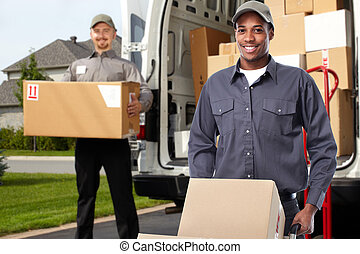 Delivery man near shipping truck. - Smiling postman with a...