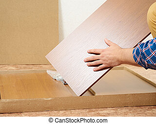 Man opens box with furniture to assemble