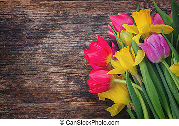 bouquet of tulips and daffodils - fresh pink tulips and...