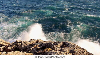 Strong waves hitting against rocks