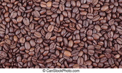 Coffee beans vertical panning video - Roasted coffee beans...