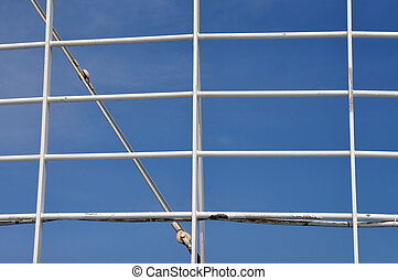 ferry boat railing - White railing and blue sky background....
