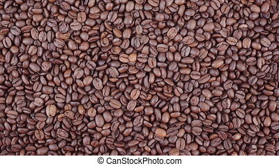 Coffee beans zoom in HD video - Roasted coffee beans zoom in...