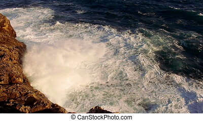 Very strong waves hitting against rocks wild water great...