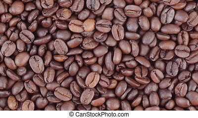 Coffee beans zoom out HD video - Roasted coffee beans zoom...