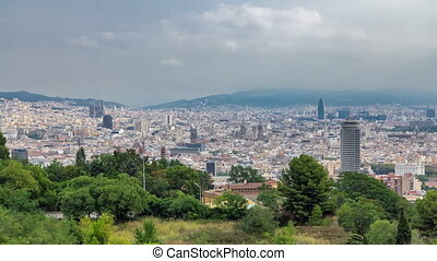 View from Montjuic over Barcelona foggy morning timelapse,...