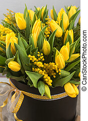 Bright spring bouquet of tulips and mimosa flowers...
