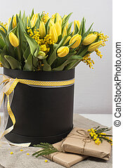 Bright spring bouquet of tulips and mimosa flowers....