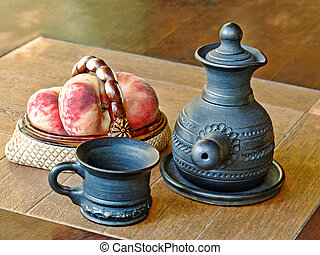 Arabian style coffee pot and peaches in ceramic vase -...