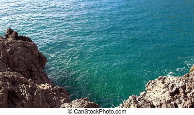 Turquois water at a rocky coast