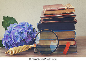 pile of old books with flowers - pile of vintage old books...