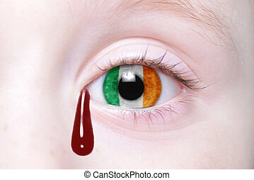 human's eye with national flag of ireland with bloody...