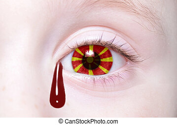 human and 39;s eye with national flag of macedonia with...